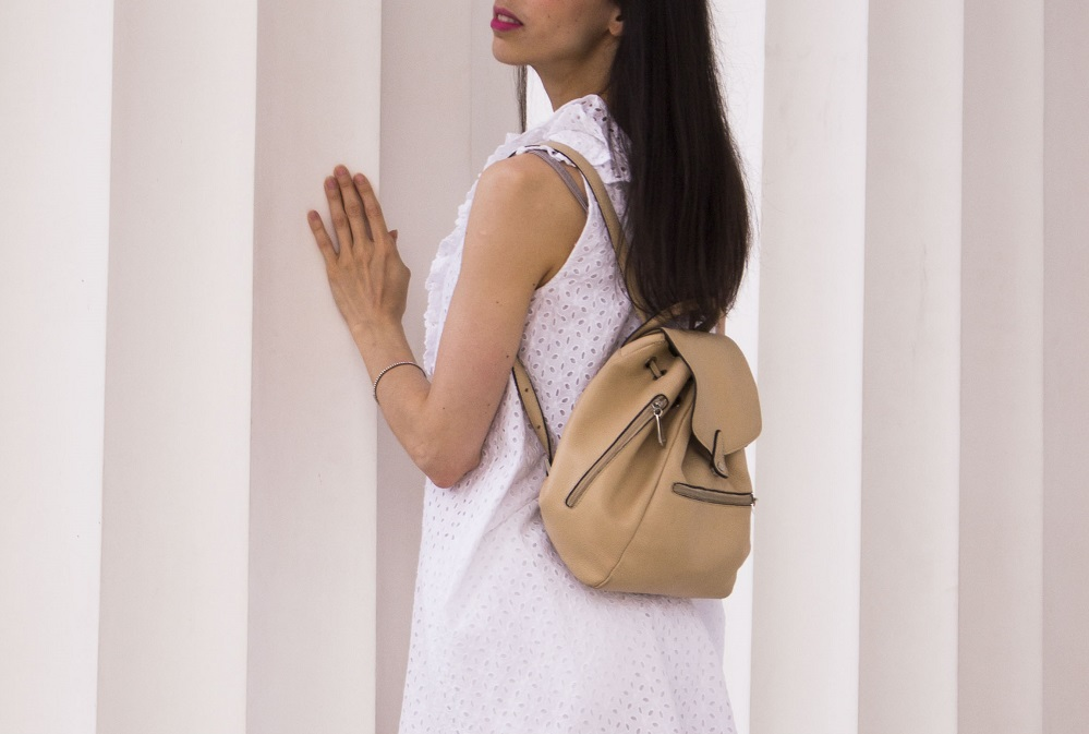 White-eyelet-dress-leather-backpack-details