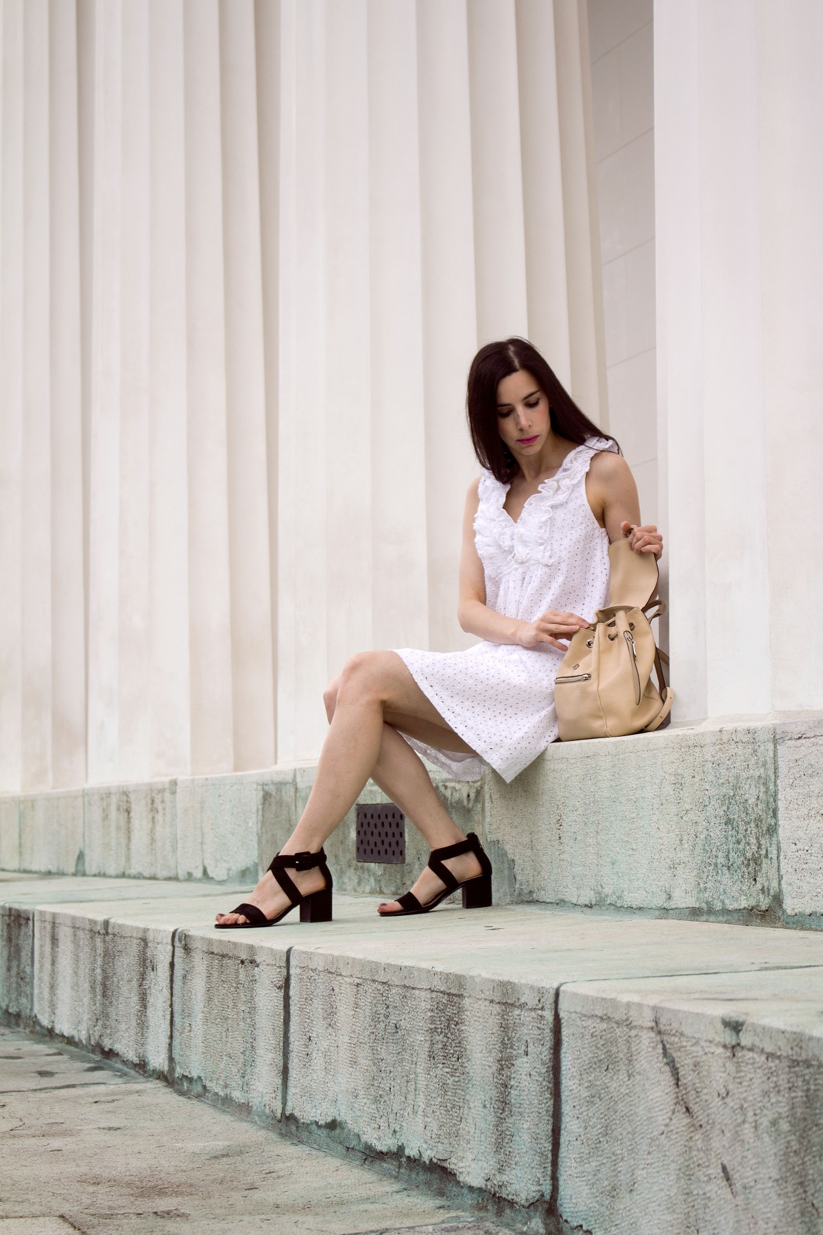 sitting on the stairs in white eyelet dress
